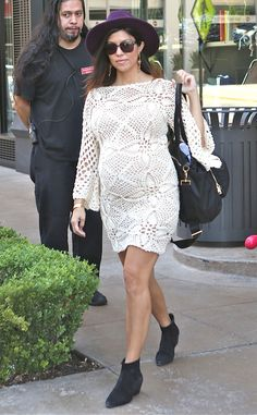 Kourtney Kardashian covers her bump in lovely white lace.