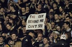 Seriously, the signs can be really funny, but I always feel bad for whoever sits behind them :/