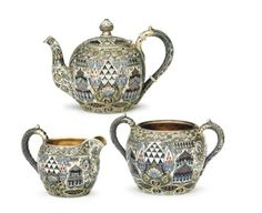 A Silver-Gilt and Cloisonne Enamel Tea Service. Marked K. Faberge with Imperial warrant and with the initials of Feodor Ruckert, Moscow, 1908-1917