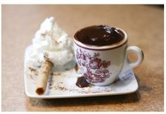 I'm not exactly sure what this is  but it looks like the thickest hot chocolate of all time...and it looks to die for!.