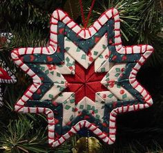 Free Small Quilted Christmas Ornaments Ribbon Quilt Ornaments - Mawicke Creations - Cincinnati, OH Folded Fabric Ornaments, Quilted Christmas Ornaments, Christmas Sewing, Christmas Fabric, Noel Christmas, Handmade Christmas, Christmas Quilting, Christmas Balls, Christmas Projects