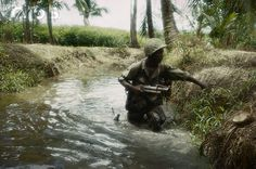 1969, Saigon --- Saigon: troops of the Ninth division wade through swamps and rivers south of Saigon in the summer of 1969, in the Delta area. --- Image by © Bettmann/CORBIS