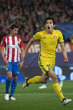 Rostov's Iranian forward Sardar Azmoun celebrates after scoring during the UEFA Champions League Group D football match Club Atletico de Madrid vs FC Rostov at the Vicente Calderon stadium in Madrid, on November 1, 2016. / AFP / CURTO DE LA TORRE