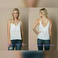 T strap back top This is a gorgeous V -neckline, sleeveless top featuring a cross strap on the front. A deep V cutout on the back with T shape strap. Partially lined. 100%polyester. Price is firm unless bundled! boutique Tops Tank Tops