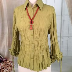Milano Green Crinkle Long Sleeve Blouse Today, featuring in Kaki Jo's closet is this cool looking crinkle green blouse.  Love the sleeves on this one.  Great condition. Size S.  Note: necklace not included.  TB46 Milano Tops Blouses