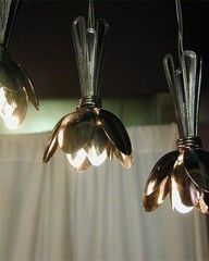 so NEAT!  light fixtures made from grouped spoons - just wrap the spoons with wire around hanging bulbs!