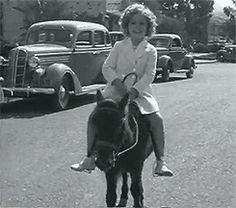 Is there anything cuter than Shirley Temple on a pony? I think not!