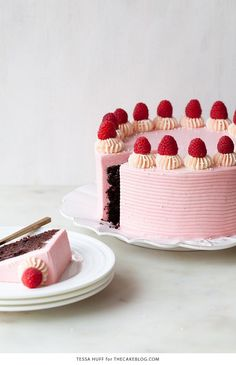 Chocolate Raspberry Cake - moist chocolate cake layered with raspberry jam, topped with raspberry cheesecake frosting and fresh red raspberries   by Tessa Huff for TheCakeBlog.com
