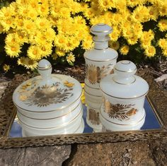 SALE....This is a vintage set of three white Opaline vanity jars. They are irradecent white with gold gilt rose & tulip design. Made in West Germany C. 1940s. Beautiful for displaying on vanity, & could be used for holding & storing items. The gold gilt is in good condition with little wear, the smallest jar does have a sliver at top where lid goes on, seen in picture 4. They are very old & do have some wear, but I consider to be good vintage condition. Please look over pictures carefully…