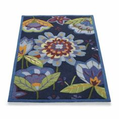 Would go perfectly with the purple/cobolt blue lamp. Cheerful and whimsical, and my Mom's favorite too. Hand-hooked Garden Indoor Area Rug