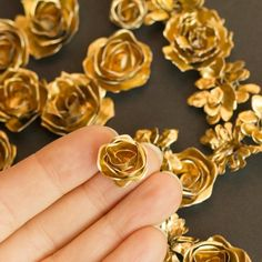 Check out this super easy way to make small metal flowers for scrapbooks or crafts!