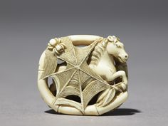 Netsuke-Horse caught in a spider's web- antique ivory