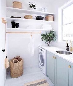 Design a #laundryroom you actually want to be in using tips from this equally soothing and functional laundry room design.