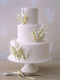 alexia dives posted lilly of the valley wedding cake to their -wedding cakes- postboard via the Juxtapost bookmarklet. White Wedding Cakes, Cool Wedding Cakes, Beautiful Wedding Cakes, Gorgeous Cakes, Wedding Cake Designs, Pretty Cakes, Purple Wedding, Gold Wedding, Rustic Wedding