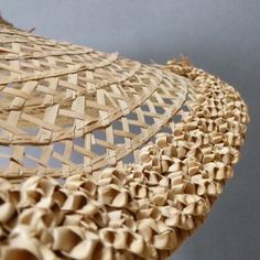 Detail, bergère (straw hat), probably made in Indonesia or the Carribean, 18th century style. The straw plaited crown with open work flat straw huge brim, the very edge with densely plaited three dimensional straw,green cotton tape ribbon.