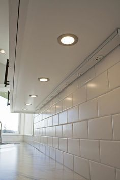 I like under the cabinet lighting.  It doesn't have to be this exact kind but something to brighten it up.