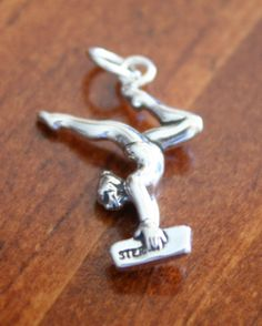 Gymnastics jewelry is a great gift for yourself, your favorite gymnast or gymnastics coach. This lady gymnast pendant looks cute worn alone on a necklace or charm bracelet.