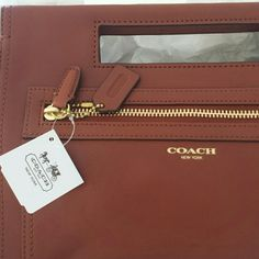 """Fourth of July Sale! Nwt Coach basket clutch Seen on many stars is this great Coach handbag clutch in a brown leather with zipper front and plenty of room inside. This is NWT and please no liwball offers! Price us firm. Bag height 7 3/4 length is 12.75"""" Coach Bags Clutches & Wristlets"""