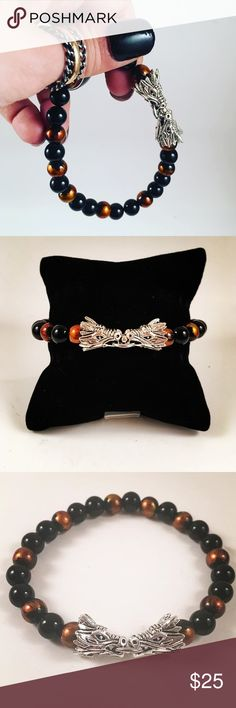 Men beaded bracelet. Tibetan silver Dragon head. Men bracelet. Fits most 7.5 to 8.5 inch wrist. Handmade by me. Never worn by anyone. Unique Beautiful black and orange/red/gold beads. Copper beads. Tibetan silver dragon head (2) . I ship fast!!😊✈️ Free gift with every purchase!!🤗🎁 Accessories Jewelry