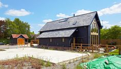 best of both - the large windows making good use of sunlight and the warmth it gives. Rigid Insulation, Oak Framed Buildings, West Facing Garden, Slate Roof, Next Door, Large Windows, Contemporary Interior, Open Plan, Ground Floor