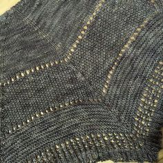"""Ravelry: Textures in triangles pattern by Linda Kuzma Free Pattern This is an """"any Yarn"""" project, the sample is made from a single skein of sock weight yarn and made a shawl 16 inches deep and 32 inches across.  It uses a garter tab cast on (explained in pattern) and increases along 5 lines to make 4 equal triangles. The pattern has five separate texture sections (straight stitch, moss stitch, garter stitch, eyelet lace and ribbed stitch) but could be done in any textures you like. There is…"""