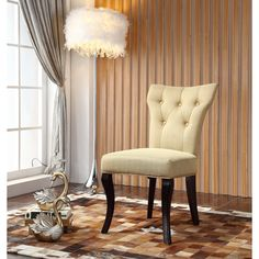 The Royal Comfort Maori Luxury dining chair will enhance any home decor. Angular legs and a uniquely styled back highlight this set, while an elegant yellow fabric and plush polyester fill complete this stylish dining set.