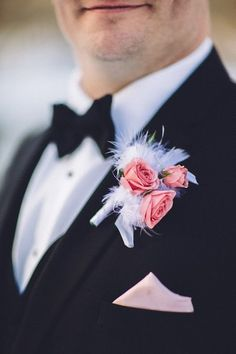 Why not add some feathers to the groom's boutonniere? {Too Much Awesomeness}