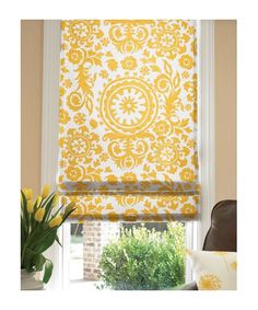Love these Roman shades - every room needs a bit of yellow and I bet you could diy with yellow fabric and mini blinds
