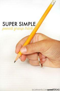 Pencil grasp trick using a keychain keyring loop