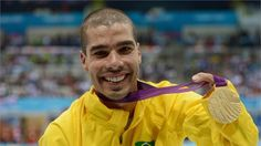 Gold medallist Daniel Dias of Brazil poses following the medal ceremony for the Men's 200m Freestyle - S5 Final on day 3 of the London 2012 Paralympic Games at the Aquatics Centre