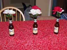 The Creative Party Mom: White Trash Birthday Bash. I can see these with plastic flowers (if you can even still get those).