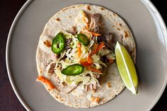 Citrus Pulled Pork Tacos by Erin Powell, food52: Made in a slow cooker!   A lighter and refreshing change to the BBQ sauce versions.  #Pulled_Pork #Erin_Powell #Citrus_Pulled_Pork #Slow_Cooker