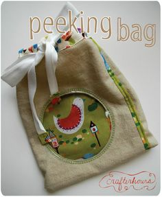 Peeking bag tutorial.  Looks a little complicated so I'll probably never make it but it's cute. :-)