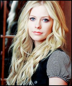 Avril Lavigne; she looks adorable when she goes light on the eyeliner :)
