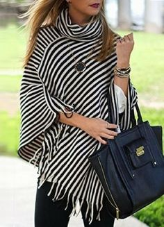 We can't get over this classic striped poncho! Ponchos are so effortless & easy to wear! This classic striped poncho is everything your wardrobe has been needing! The classic stripes make this a must- White Poncho, Striped Turtleneck, Poncho Outfit, Casual Outfits, Cute Outfits, Fall Outfits, Ladies Poncho, Moda Chic, Winter Stil