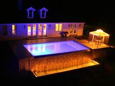 Rectangular vanishing edge pool at night