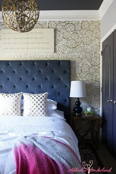 A vintage chic bedroom makeover features light gray walls, wide plank gray hardwood flooring, dark ceiling and beautiful gold floral wallpaper. Gold, gray and purple are the perfect combination in this stunning bedroom reveal!