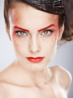 Love the red lips and eye brows, but the red splatter is kind of creepy. Could be cool in yellow, green or blue.