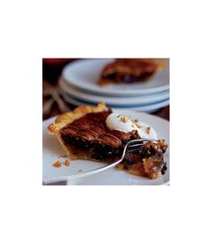 As simple to make as it is sinfully good: Sprinkle a store-bought pie crust with chocolate chips and pour in a traditional pecan pie filling. Bake until the crust and pecans are browned, then serve with a homemade Kahlúa whipped cream once cooled. Get the recipe.  - WomansDay.com