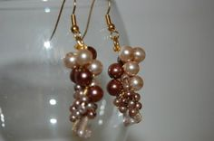 Berries Earrings - ML163E  Feminine earrings with lilac and pale pink glass beads. Crocheted with metallic fabric gold thread. Gold-plated earring base.  $26.00  http://www.melissajewelrydesign.com/berries-earrings