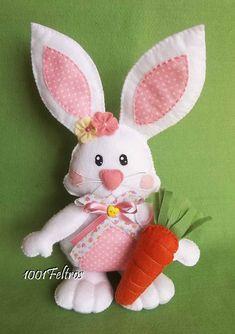 Decoração para a Páscoa, coelhinhos de feltro.    Com cerca de 30 cm de altura, feitos em tons de rosa a pedido da cliente.     Um com o...
