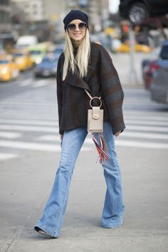 Straight from fashion week street style: classic jeans, a great coat, and a tiny bag with bright, notice-me rainbow fringe. Click for more outfits with the bag (and info on where you can buy it)