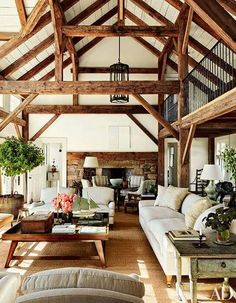 Reclaimed timber beams accent the barnlike common room at Lynn and Sir Evelyn de Rothschild's Martha's Vineyard home, which was built by Rivkin/Weisman Architects and decorated by Mark Cunningham. Perfect example of too much going on. Architectural Digest, Sweet Home, Common Room, Style At Home, Country Style Homes, House In The Woods, Home And Living, Cozy Living, Living Room Cabin
