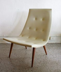 great piece for a mid-century modern space.  Could be a side chair in a living room or bedroom