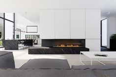 Minimalist fireplace and custom cabinetry