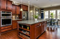 Storage tucked into the island adds to this stylish kitchen. The Tangerly Oak plan, a new home by Del Webb. The Carolina Arbors by Del Webb community. Durham, NC.