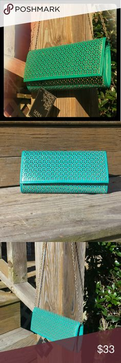 Turquoise clutch with chain Beautiful laser cut detail! Removable chain included. MMS Design Studio Bags Clutches & Wristlets
