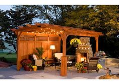 Pergola with fairy lights and fireplace.