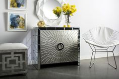 """36"""" w x 18"""" d x 32"""" h $900 Materials: Wood, glass Measurements:36"""" w x 18"""" d x 32"""" h The cabinet has 1 shelf, distance between shelves is 12"""". Color: Silver, reflective"""