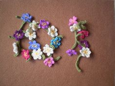With these simple crochet flowers you can make a daisy chain that lasts all summer. The flowers have a hole in the stem so they can be threaded together just like the real thing. Make them in white or use lots of colours and string them together to make bracelets, necklaces or garlands. An ideal present for children or anyone who remembers making daisy chains when the summers were always long.
